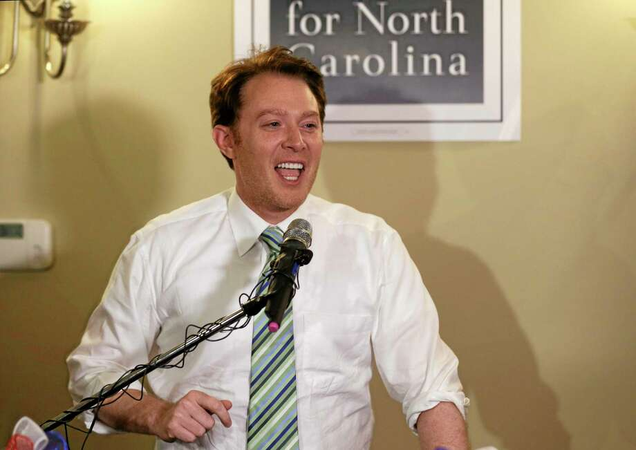 Clay Aiken speaks to supporters during an election night watch party in Holly Springs, N.C., Tuesday, May 6, 2014. Aiken is seeking the Democratic nomination for North Carolina's 2nd Congressional District. (AP Photo/Gerry Broome) Photo: AP / AP