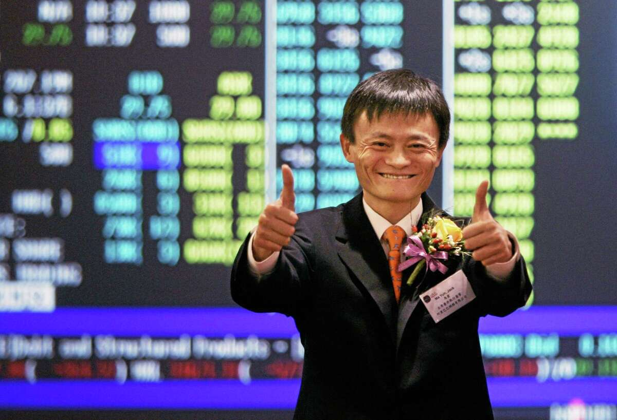 FILE - In this Nov. 6, 2007 file photo, Jack Ma, founder and CEO of Alibaba, celebrates at his company listing ceremony at the Hong Kong Stock Exchange. The mammoth IPO planned by e-commerce giant Alibaba Group highlights founder Maís improbable rise to Chinaís entrepreneur-in-chief. (AP Photo/Kin Cheung, File)