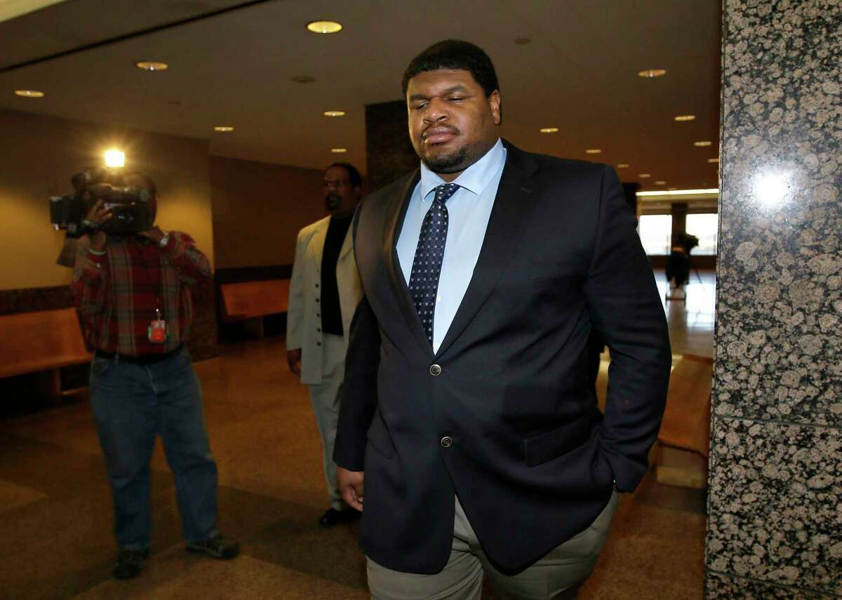 In this Jan. 17 file photo, Dallas Cowboys defensive tackle Josh Brent leaves a courtroom following a day in his trial for intoxication manslaughter in Dallas.