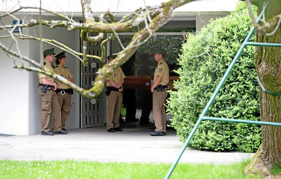Police officers stand in front of a house where art collector Cornelius Gurlitt lived, in Munich, Germany, Tuesday, May 6, 2014. Gurlitt, a reclusive German collector whose long-secret hoard of well over 1,000 artworks triggered an international uproar over the fate of art looted by the Nazis, died Tuesday. He was 81.Photo (AP Photo/dpa, Sven Hoppe) Photo: AP / dpa