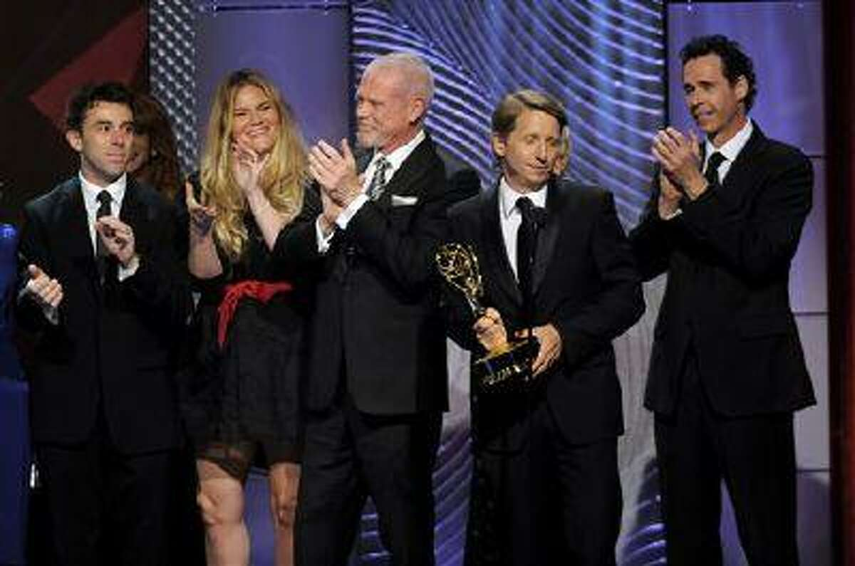 """The cast and crew of """"The Bold and the Beautiful"""" accept the award for outstanding drama series writing team at the 40th Annual Daytime Emmy Awards on Sunday, June 16, 2013, in Beverly Hills, Calif. (Photo by Chris Pizzello/Invision/AP)"""