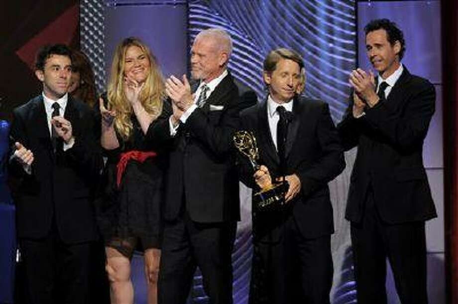 """The cast and crew of """"The Bold and the Beautiful"""" accept the award for outstanding drama series writing team at the 40th Annual Daytime Emmy Awards on Sunday, June 16, 2013, in Beverly Hills, Calif. (Photo by Chris Pizzello/Invision/AP) Photo: Chris Pizzello/Invision/AP / Invision"""