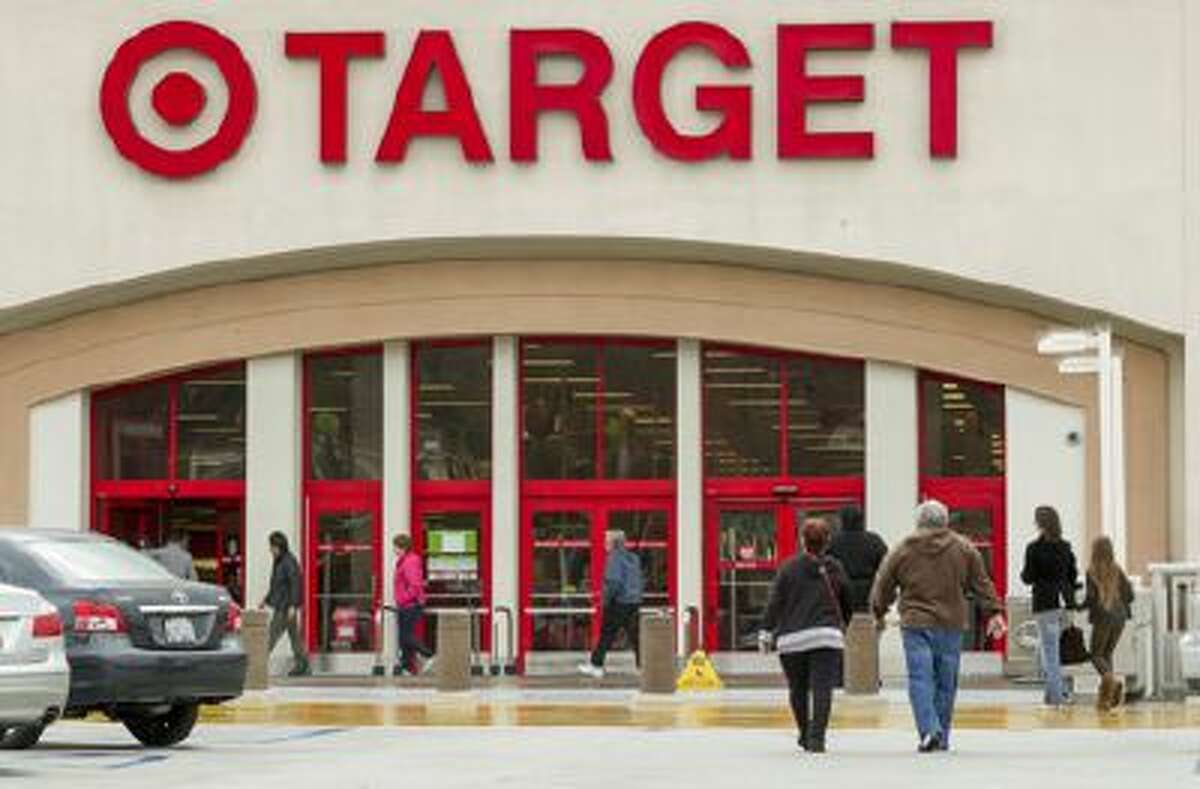 Shoppers arrive at a Target store in Los Angeles on Thursday, Dec. 19, 2013. Target says that about 70 million credit and debit card accounts may have been affected by a data breach that occurred just as the holiday shopping season shifted into high gear.