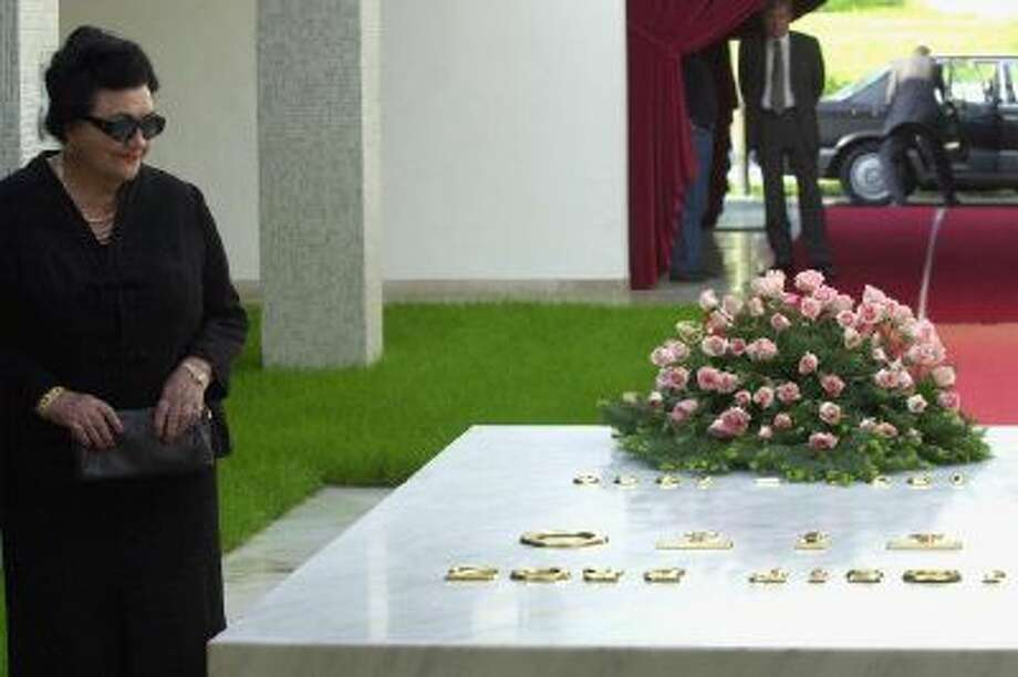 In this Friday, May 4, 2001 file photo, Jovanka Broz, the widow of former Yugoslav President Josip Broz Tito stands by his tomb after laying a wreath during a ceremony in Belgrade, Serbia. Hospital officials announced on Sunday, Oct. 20, 2013, that Jovanka Broz, the widow of former Yugoslav dictator Josip Broz Tito, has died. She was 89.