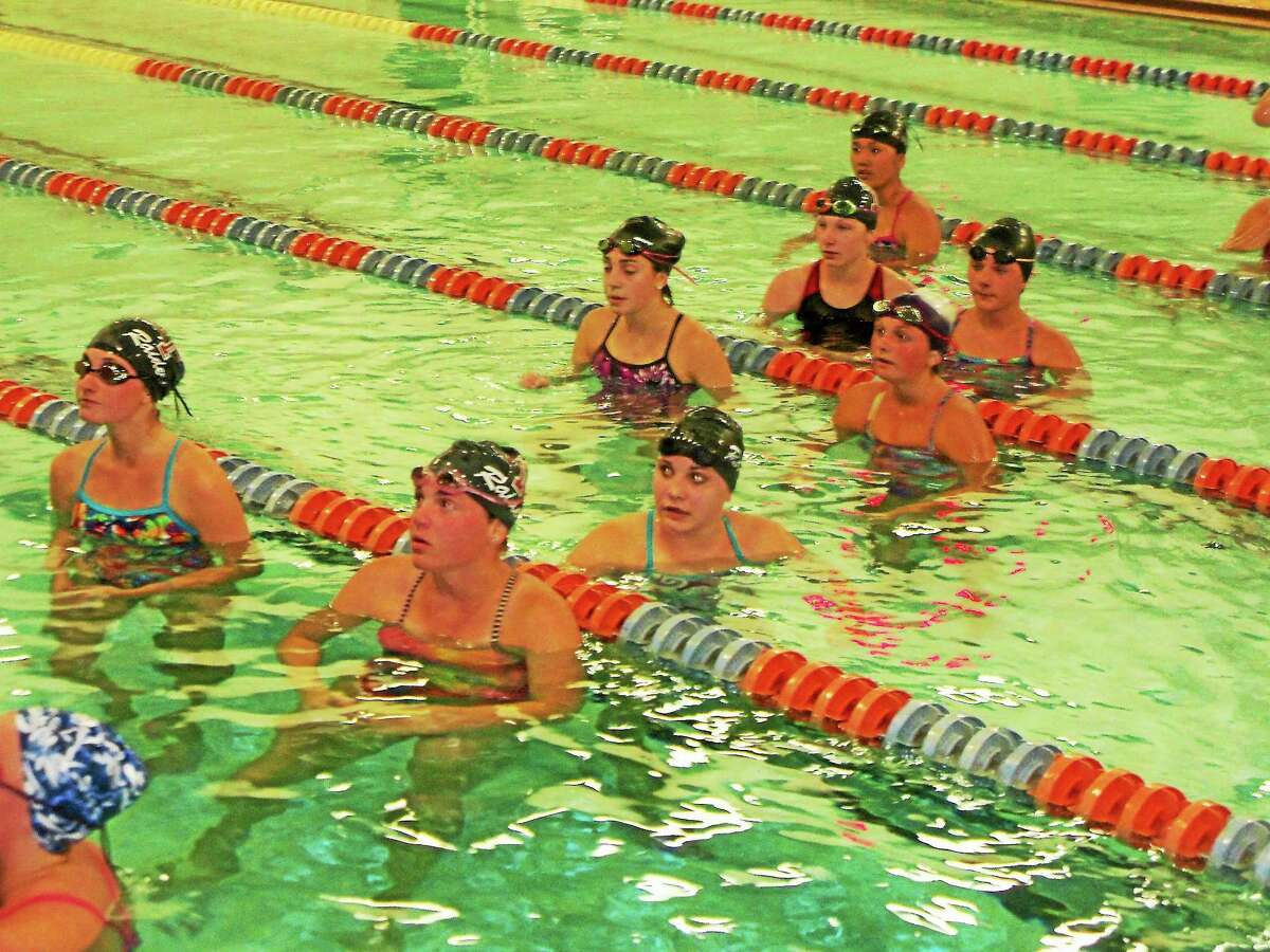 Torrington swimmers listen to instructions during a practice this pre-season.
