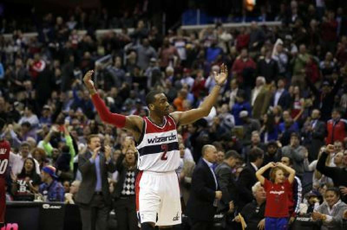 Wizards guard John Wall celebrates in the second half of Washington's 114-97 win over Miami.