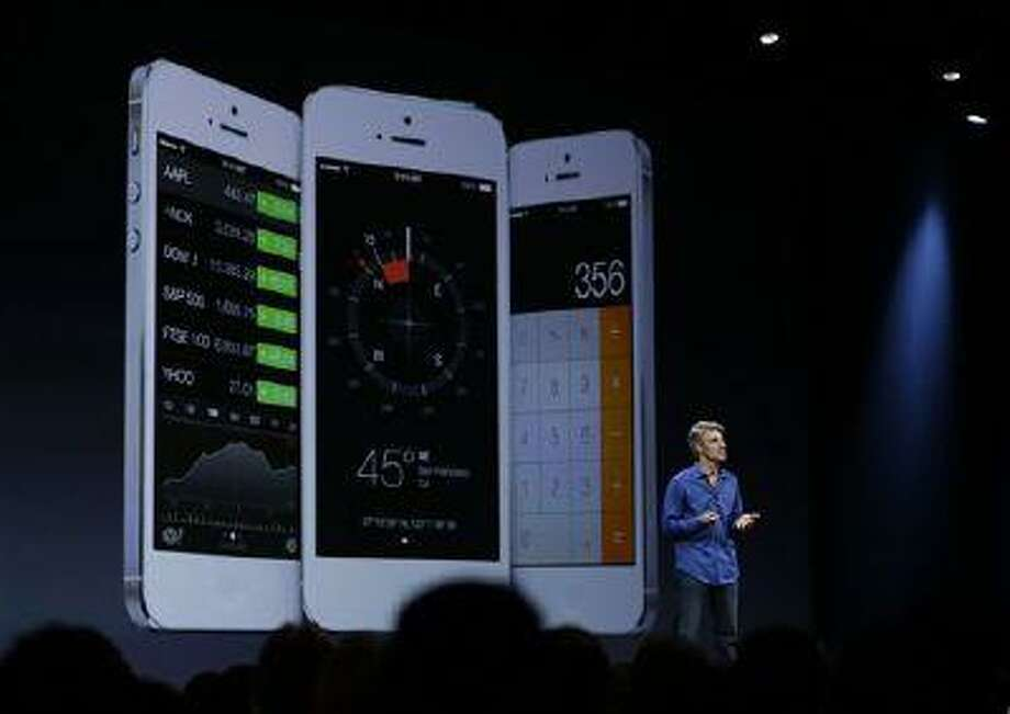 Craig Federighi, senior vice president of Software Engineering at Apple talks about the features of the new iOS 7 during the keynote address of the Apple Worldwide Developers Conference Monday, June 10, 2013 in San Francisco. (AP Photo/Eric Risberg) Photo: AP / AP