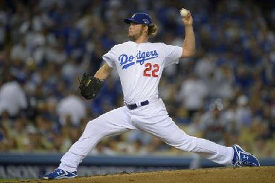 Clayton Kershaw pitches in Game 4 of the NLDS against the Braves.