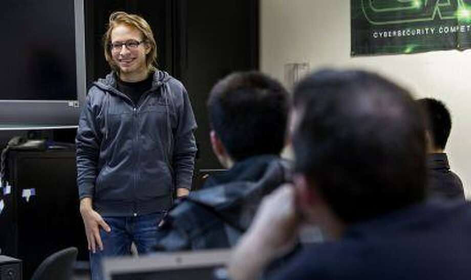 """Julian Cohen, 22, a senior at the Polytechnic Institute of New York University (NYU-Poly) and a founder of the weekly Wednesday evening """"Hack Night,"""" asks students questions in the Information Systems and Internet Security (ISIS) lab at the university Wednesday, April 10, 2013, in New York. The group of students are not getting together to learn how to hack computer data bases, rather they are studying to become cybersecurity experts to hopefully foil such attacks. (AP Photo/Craig Ruttle) Photo: ASSOCIATED PRESS / AP2013"""