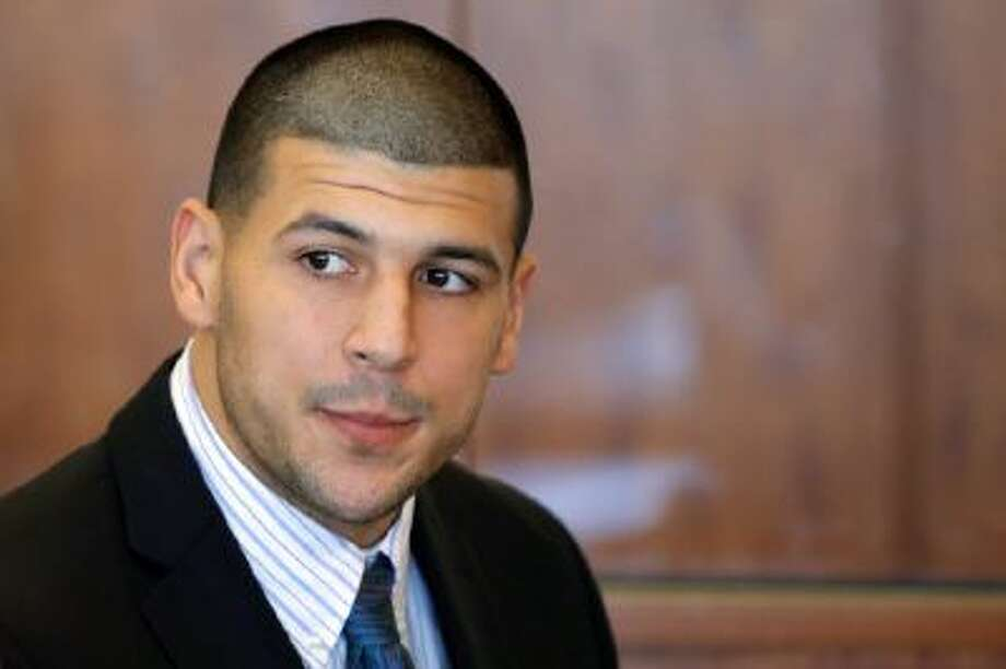 Former New England Patriots NFL football player Aaron Hernandez attends a pretrial court hearing in Fall River, Mass. on Wednesday, Oct. 9, 2013. Hernandez was indicted in August in the killing of 27-year-old Odin Lloyd, a semi-professional football player from Boston who was dating the sister of Hernandez's girlfriend. He has pleaded not guilty.