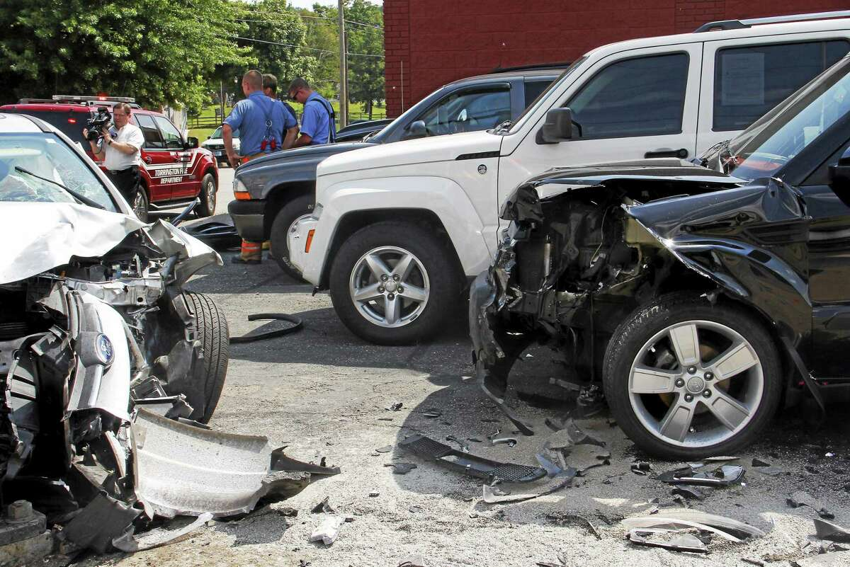 The car accident caused severe damage to three vehicles, including the black SUV on the right, at a nearby car dealership.