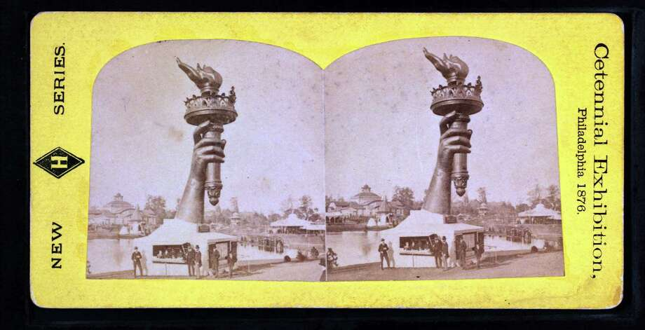 "Collossal hand and torch. Bartholdi's statue of ""Liberty.""."
