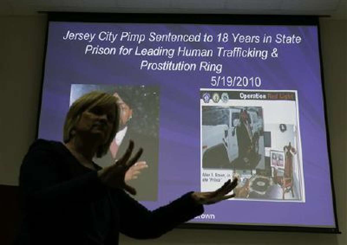 Kathleen Friess gives a presentation on human trafficking in Hamilton Township, N.J., for hotel and nightclub employees and tries to clarify notions of what human trafficking looks like.