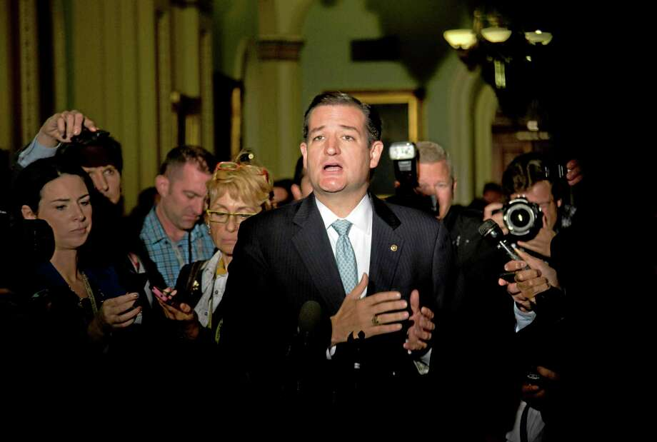 In this Oct. 16, 2013, file photo Sen. Ted Cruz, R-Texas, talks to reporters on Capitol Hill in Washington after House leaders reached a last-minute agreement to avert a threatened Treasury default and reopen the government after a partial, 16-day shutdown. Cruz made a name for himself by leading the tea party charge toward shutdown. About half of the respondents in a recent Associated Press-GfK poll knew enough about Cruz to form an opinion, impressive for a senator elected less than a year ago. The bad news for Cruz? Their opinion was negative by a 2-1 margin. Photo: Carolyn Kaster—File—The Associated Press  / AP
