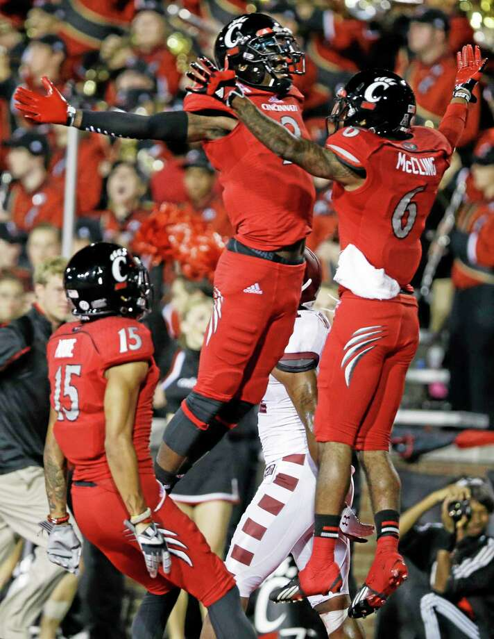 Cincinnati wide receiver Anthony McClung (6) celebrates with Mekale McKay (2) after McClung scored on a 25-yard pass against Temple on Oct. 11 in Cincinnati. Photo: Al Behrman — The Associated Press  / AP