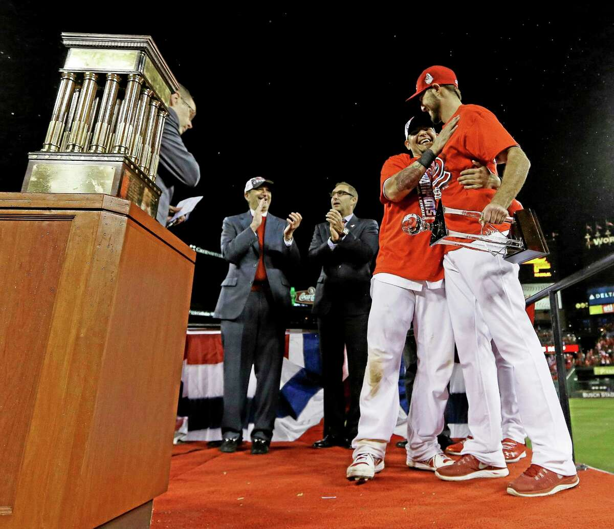 Cardinals catcher Yadier Molina and starter Michael Wacha celebrate after Game 6 of the National League championship series against the Los Angeles Dodgers on Friday in St. Louis. The Cardinals won 9-0 to win the series.