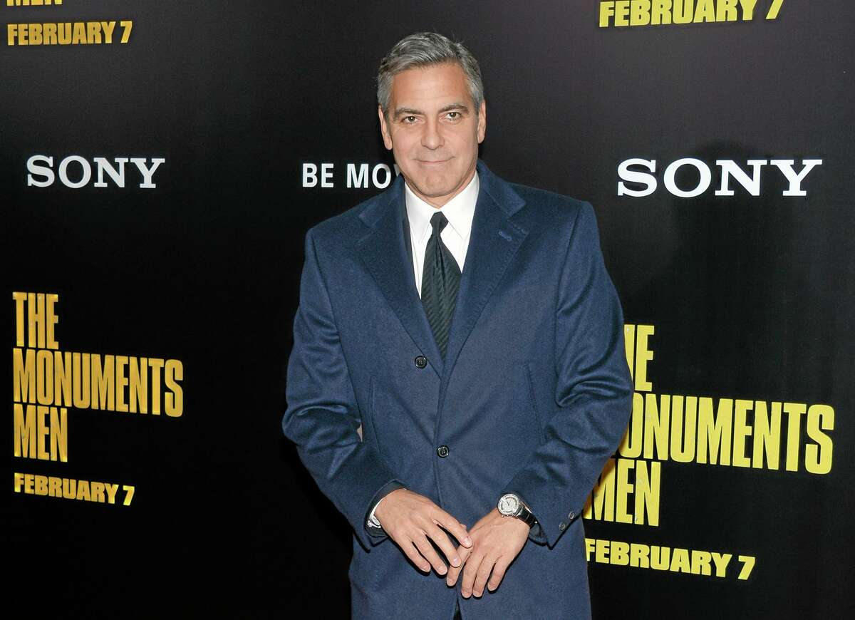 """In this Feb. 4, 2014, file photo, director and actor George Clooney attends the premiere of """"The Monuments Men"""" at the Ziegfeld Theatre in New York."""