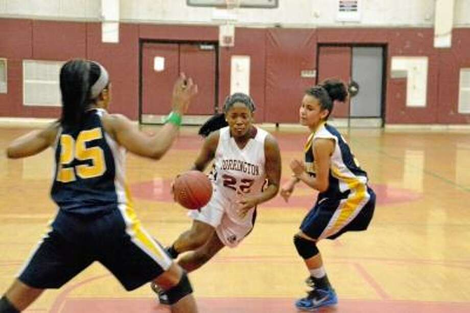 Torrington's Mika Howard cuts through two Kennedy defenders in the Raiders' victory against Kennedy.