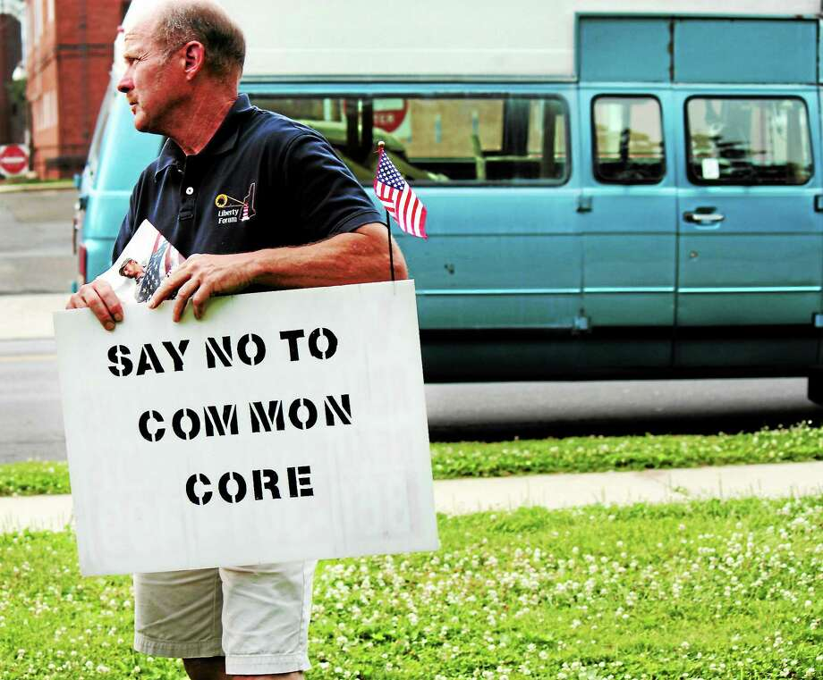 Patrick Lacy from East Haddam stands in front of West Haven City Hall protesting against the Common Core Curriculum in June 2013. Photo: Nicole Dellolio — NEW HAVEN REGISTER
