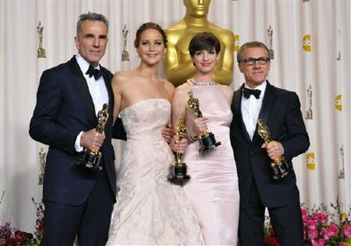 """From left, Daniel Day-Lewis, with his award for best actor in a leading role for """"Lincoln,"""" Jennifer Lawrence, with her award for best actress in a leading role for """"Silver Linings Playbook,"""" Anne Hathaway, with her award for best actress in a supporting role for """"Les Miserables,"""" and Christoph Waltz,with his award for best actor in a supporting role for """"Django Unchained,"""" pose during the Oscars at the Dolby Theatre on Sunday Feb. 24, 2013, in Los Angeles. (Photo by John Shearer/Invision/AP)"""