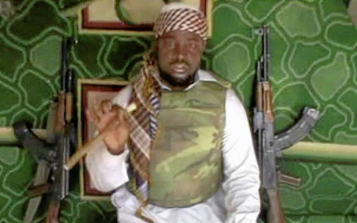 This file image made available Wednesday, Jan. 10, 2012, taken from video posted by Boko Haram sympathizers, shows the leader of the radical Islamist sect Imam Abubakar Shekau. Boko Haram has claimed responsibility for the April 15, 2014, mass abduction of nearly 300 teenage schoolgirls in northeast Nigeria. Even before the kidnapping, the U.S. government was offering up to a $7 million reward for information leading to the arrest of Shekau, whom the U.S. has labeled a specially designated global terrorist.