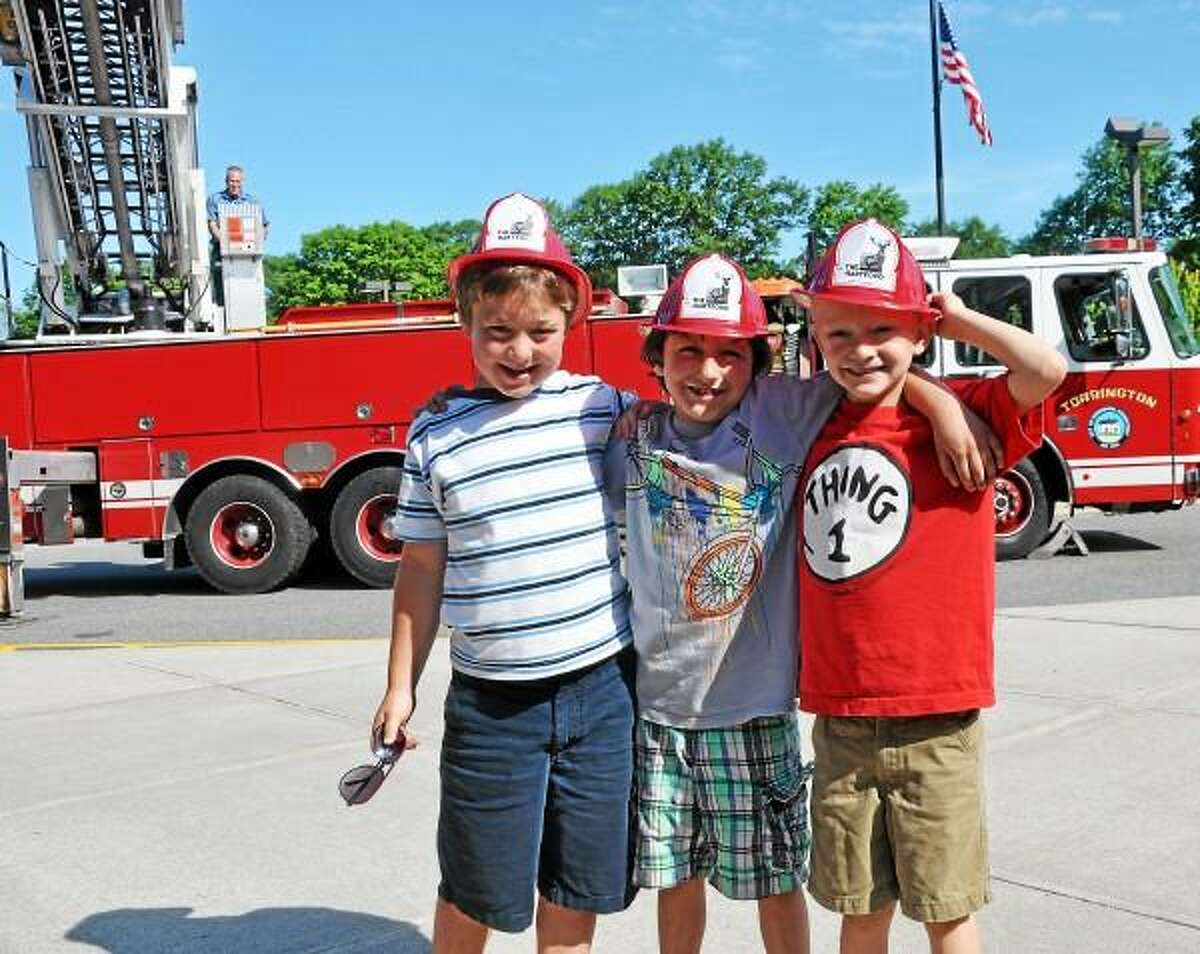 Tommy Pataky, Tristan Ladona, and Owen Nilsen in front of the fire truck they rode to school Monday morning. (Photo courtesy of Rebekah Ladonna - bekahphotography)