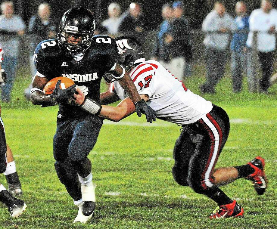 Register sports columnist Chip Malafronte this week gives step-by-step instructions for all those youngsters out there with visions of breaking Ansonia running back Arkeel Newsome's state career rushing yardage record. It starts with being named the starting varsity running back as a freshman and reaching four consecutive state championship games. After that, it gets a little more difficult. Photo: Peter Casolino — Register