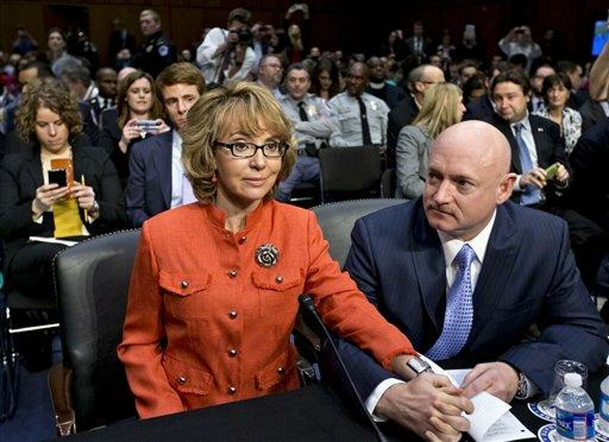 In this Jan. 30, 2013 file photo, former former U.S. Rep. Gabrielle Giffords, who survived a gunshot to the head in 2011, during a mass shooting in Tucson, Ariz., sits ready with her husband, retired astronaut Mark Kelly, at a Senate Judiciary Committee hearing on Capitol Hill in Washington to discuss legislation to curb gun violence. Giffords and Kelly are scheduled to be in Denver, Monday, March 4, 2013 to testify in support of at least one of the seven gun-control bills being considered by the Colorado Legislature. Eileen McCarron, president of the Colorado Ceasefire Capitol Fund, says Kelly will speak in support of a House bill that requires all private gun sales and transfers to be subject to a background check. (AP Photo/J. Scott Applewhite, File)