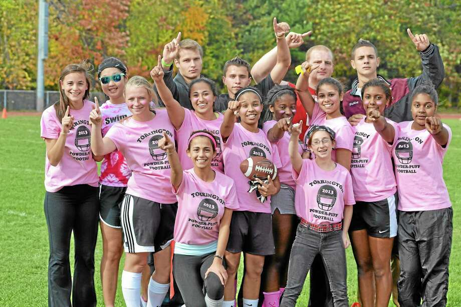 The Torrington senior powderpuff team and its coaches after they won the powderpuff championship. On the way to its championship they defeated the sophomores and then the freshmen in the title game. A slideshow of the games is on gametimect.com Photo: Pete Paguaga — Register Citizen