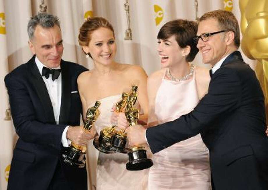 Daniel Day-Lewis, Jennifer Lawrence, Anne Hathaway and Christophe Waltz in the press room during the 85th Annual Academy Awards held at the Loews Hollywood Hotel on February 24, 2013 in Hollywood, California. Photo: FilmMagic / 2013 Jennifer Graylock
