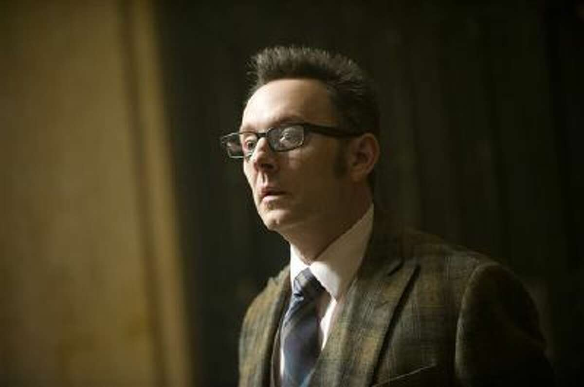 """This photo provided by CBS Entertainment shows Michael Emerson in a scene from the TV series, """"Person of Interest."""" The show airs Tuesdays, 10:00 p.m. ET/PT on the CBS Television Network. The ?Person of Interest? producers on a panel at the Television Critics Association on Wednesday, Jan. 15, 2014, said their show?s stories about surveillance of ordinary citizens, have turned out to reflect real events."""