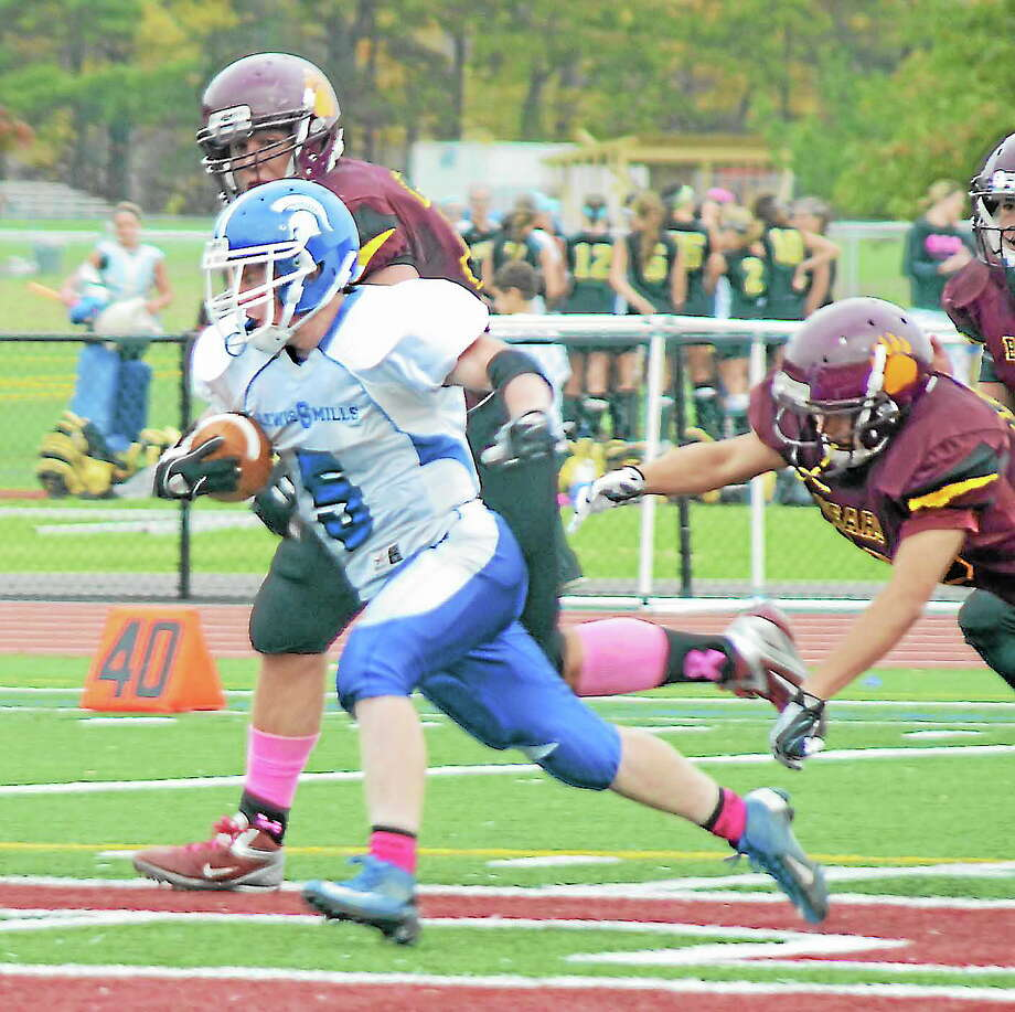 Max Stone (5) races for yardage in Saturday's game with Granby. Photo: Gerry DeSimas Jr. — CollinsvillePress.com