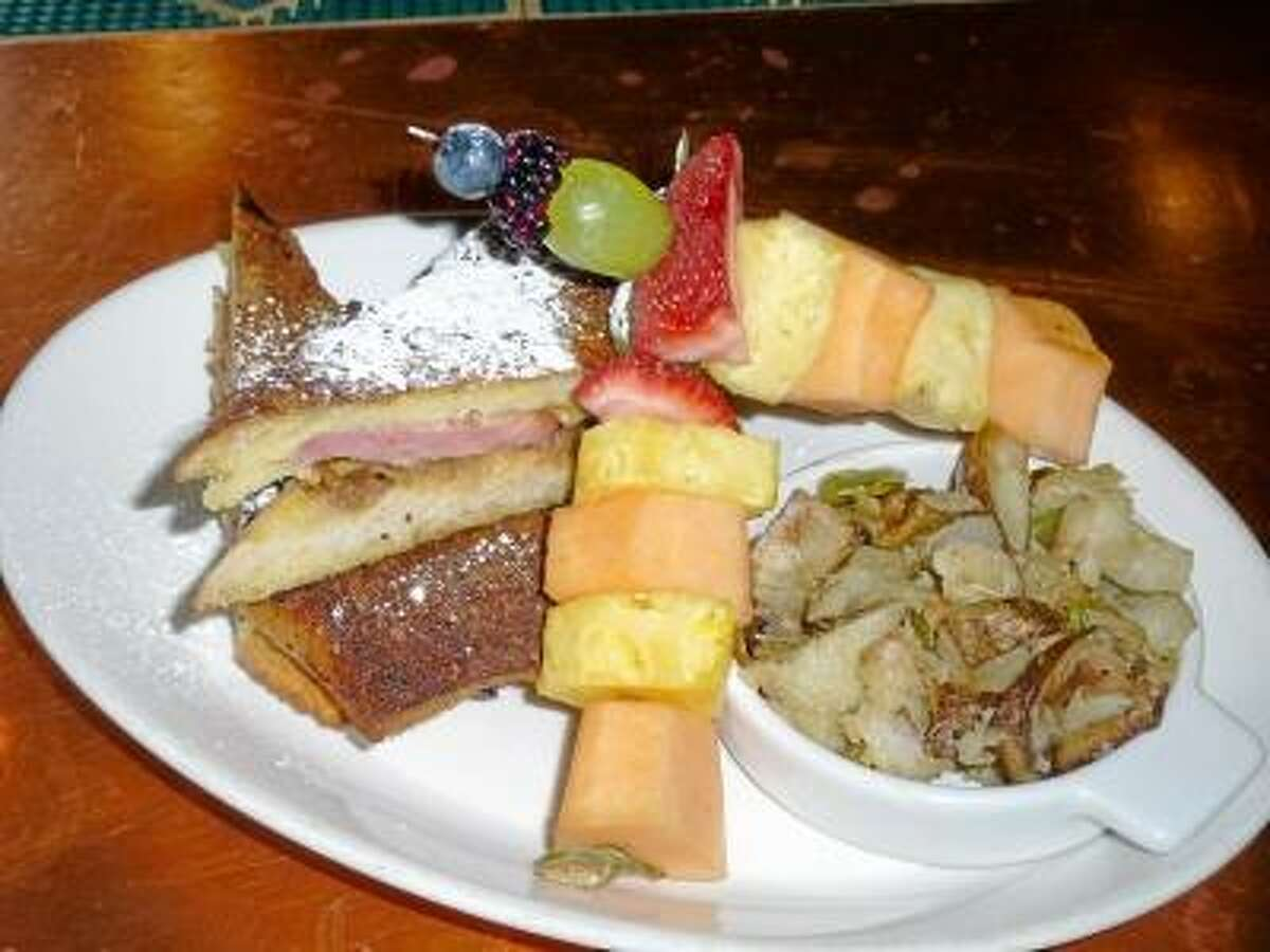 Ryan Flynn/Register Citizen -- The Monte Cristo sandwich, served with fresh fruit and home fries, was one of the specials on the menu for the Easter Brunch.