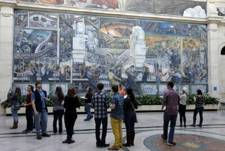 Visitors look at the Detroit Industry Murals by the Diego Rivera at the Detroit Institute of Arts in Detroit