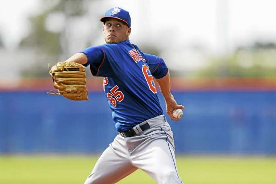 New York Mets pitcher Zack Wheeler throws a live batting practice session during spring training baseball, Wednesday, Feb. 20, 2013, in Port St. Lucie, Fla. (AP Photo/Julio Cortez) Photo: ASSOCIATED PRESS / AP2013