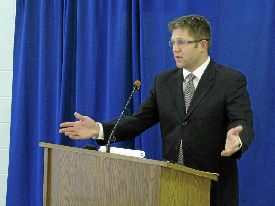 """Federal public defender Allen Bohnert talks about the execution of his client, death row inmate Dennis McGuire, by a never-tried lethal drug process, on Thursday, Jan. 16, 2014 at the Southern Ohio Correctional Facility in Lucasville, Ohio. After McGuire repeatedly gasped over several minutes before dying, Bohnert called the procedure """"a failed agonizing experiment by the state of Ohio.î (AP Photo/Andrew Welsh-Huggins) Photo: AP / AP"""