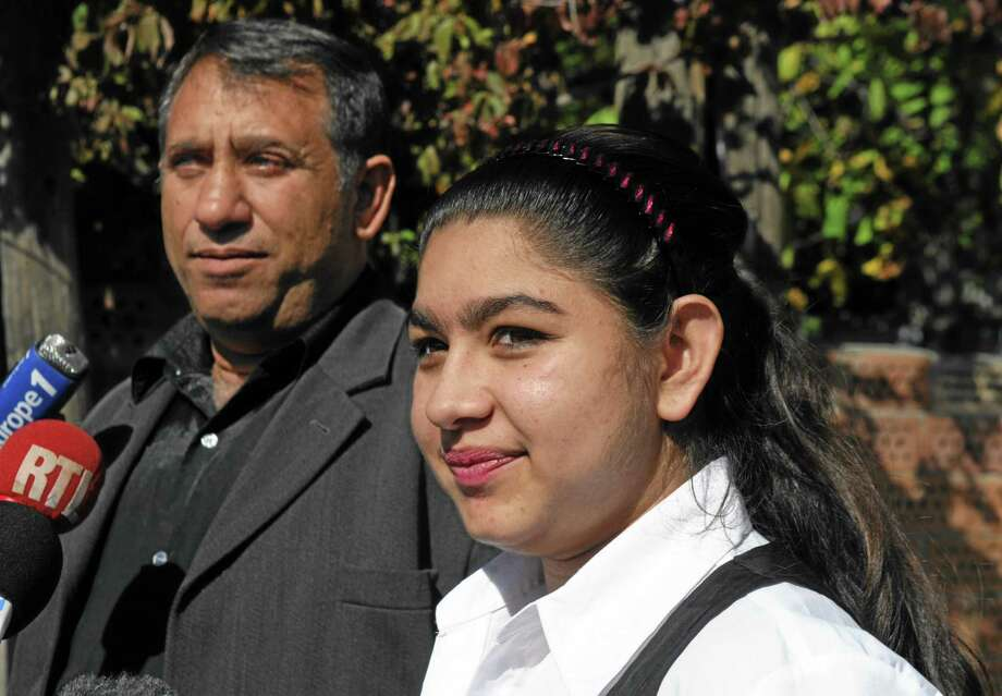 Leonarda Dibrani, 15, who was expelled from France the previous week, speaks to media  in Kosovo's northern town of Mitrovica on Friday, Oct 18, 2013. Under fire from the far left and members of his own party, Socialist President Francois Hollande said Saturday that the  girl ,who was detained in front of her classmates and deported, can return to France. But the rest of the family cannot come with her. Leonarda  said she would not return without her family. (AP Photo/STR) Photo: AP / AP