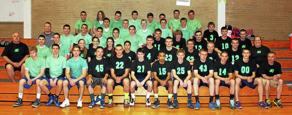 Both the Wolcott Tech and Lewis Mills boys volleyball teams wore green in support of Mental Health Awareness.