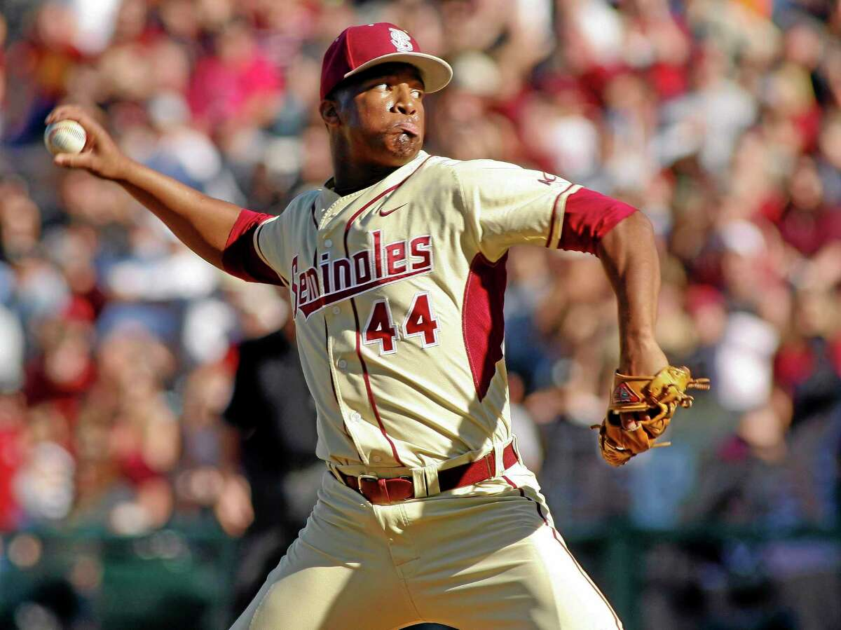 In this March 2 file photo, Florida State relief pitcher Jameis Winston throws in the ninth inning of a game against Miami in Tallahassee, Fla.