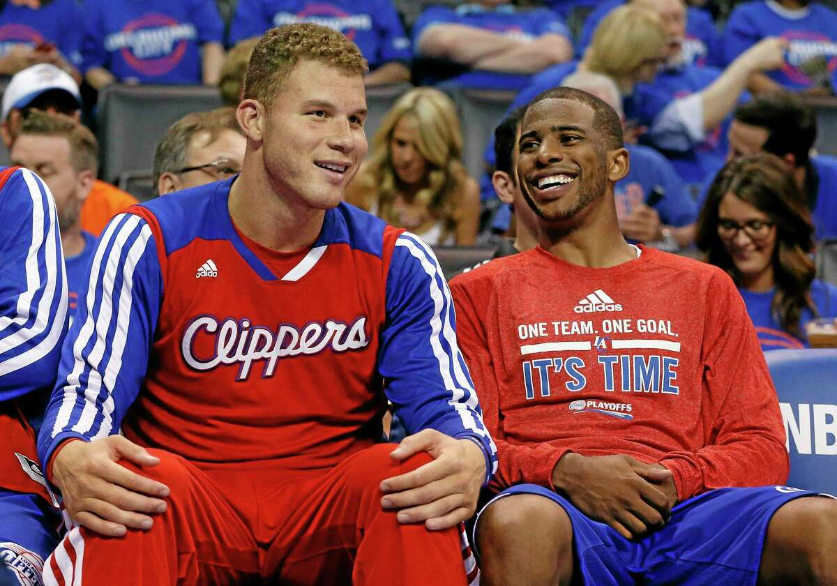 Los Angeles Clippers guard Chris Paul, right, laughs with teammate Blake Griffin as they sit on the bench in the fourth quarter of Game 1 of the Western Conference semifinals in Oklahoma City on Monday. Los Angeles won 122-105.