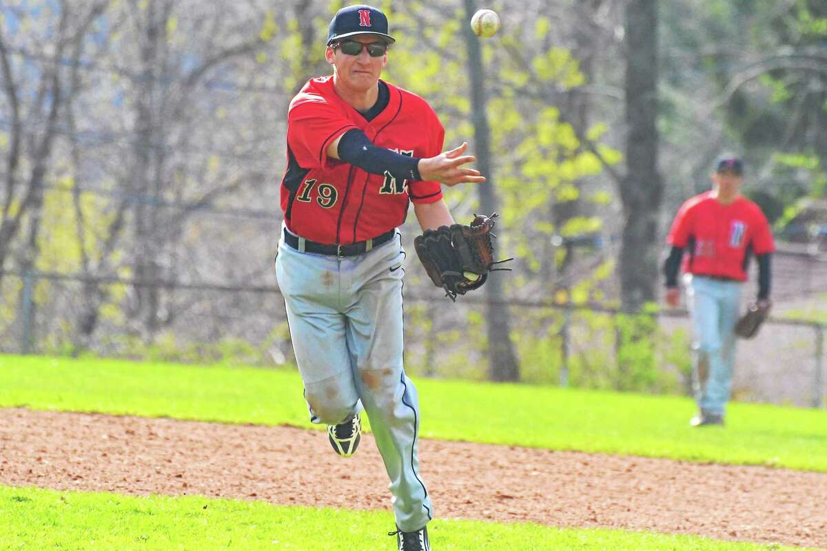 Pete Paguaga Register Citizen Northwestern's Tony Pucino throws out a runner at first base in the Highlanders' 6-0 loss to Lewis Mills.