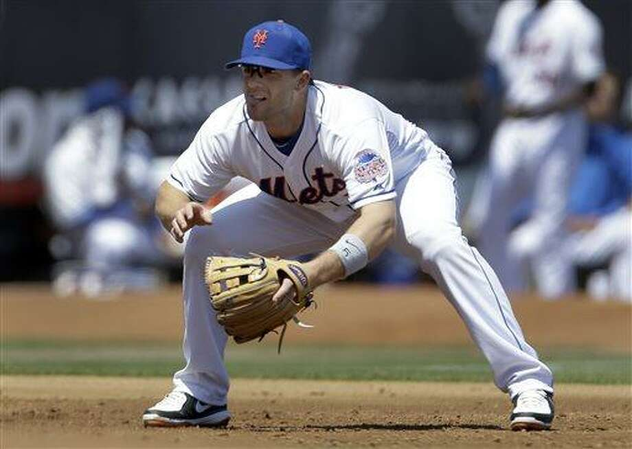 New York Mets third baseman David Wright works at his position during the second inning of an exhibition spring training baseball game against the St. Louis Cardinals Friday, March 29, 2013, in Port St. Lucie, Fla. (AP Photo/Jeff Roberson) Photo: ASSOCIATED PRESS / AP2013
