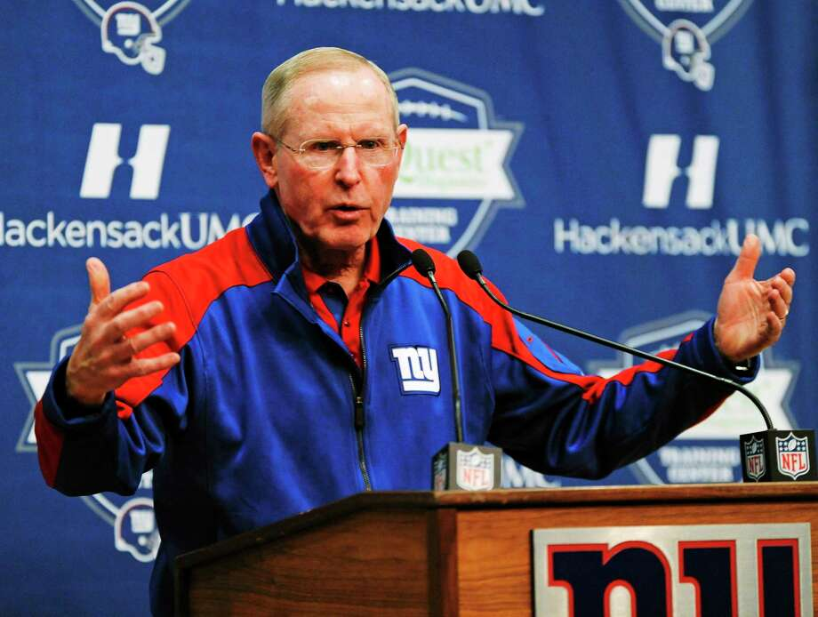 New York Giants coach Tom Coughlin fired assistant coaches Mike Pope and Jerald Ingram on Wednesday. Photo: Bill Kostroun — The Associated Press  / FR51951 AP