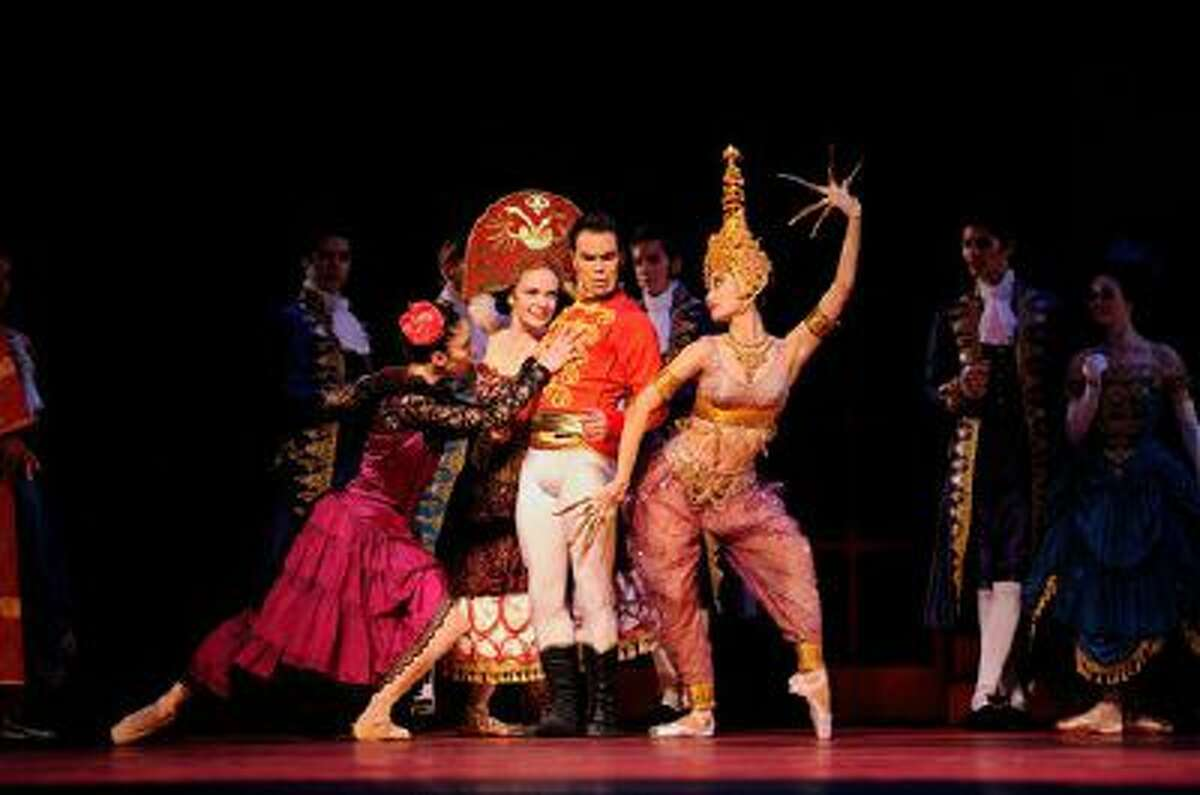 """This 2013 photo provided by the San Francisco Ballet shows, from left, Dores Andre, Sasha De Sola, Joan Boada and Wan Ting Zhao, in Wheeldon's """"Cinderella."""" The production arrives at New York?s David H. Koch Theater at Lincoln Center on Oct. 23."""