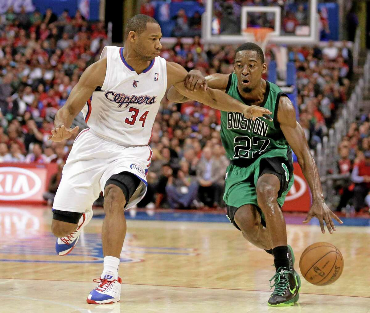 The Boston Celtics traded guard Jordan Crawford, right, and MarShon Brooks to Golden State on Wednesday as part of a three-team deal with Miami.