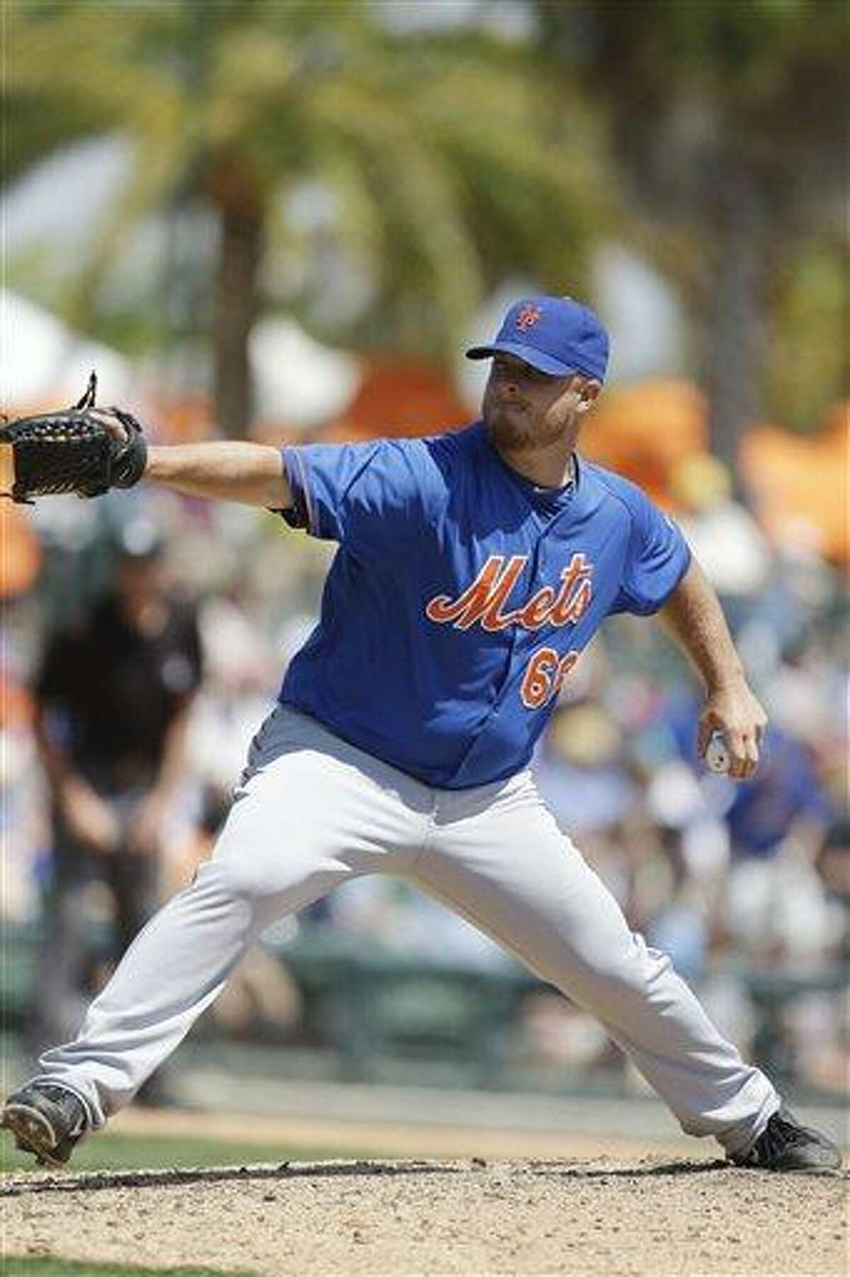 New York Mets relief pitcher Josh Edgin prepares to throw during the seventh inning of an exhibition spring training baseball game against the against the Baltimore Orioles, Saturday, March 30, 2013, in Sarasota, Fla. (AP Photo/Carlos Osorio)