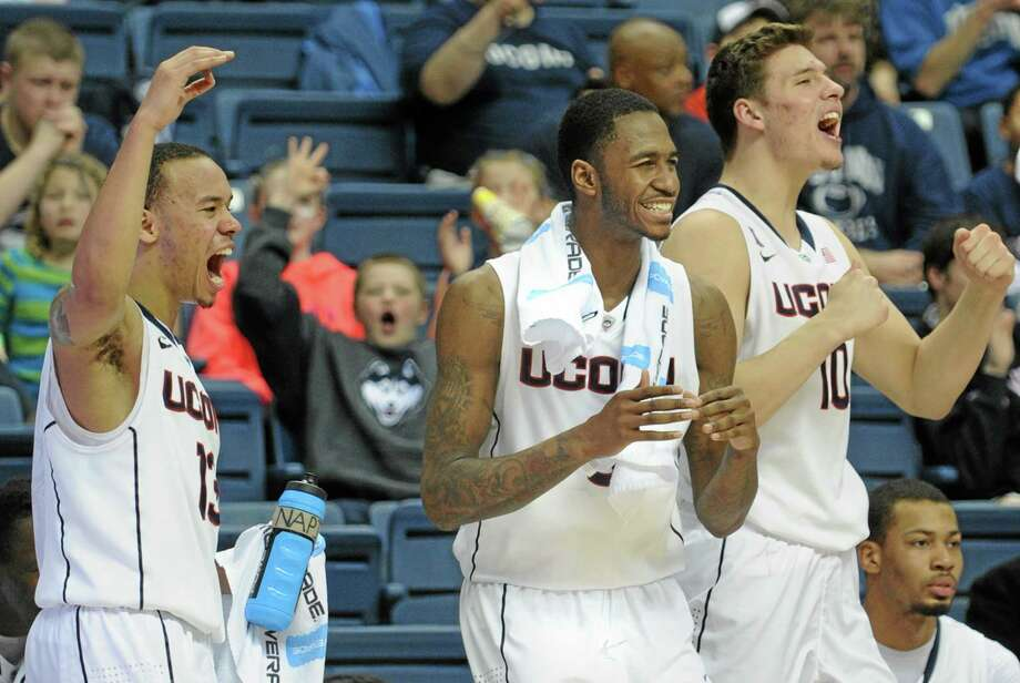 UConn players like Shabazz Napier (13),  Phillip Nolan  (0), and Tyler Olander (10) hope to be celebrating after Wednesday's game at Memphis. Photo: Gretchen Ertl  — The Associated Press  / FR170046 AP