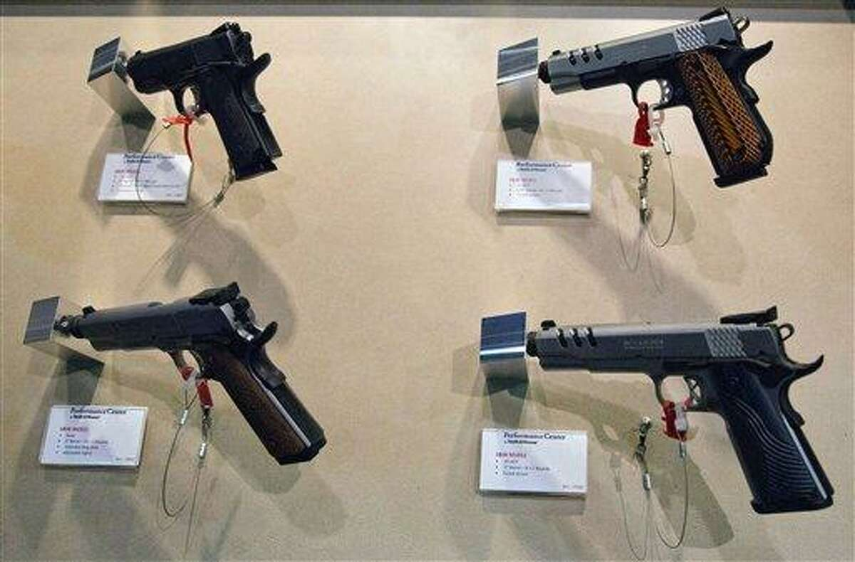 Several of Smith & Wesson new product pistols are displayed at the 35th annual SHOT Show, Tuesday, Jan. 15, 2013, in Las Vegas. The National Shooting Sports Foundation was focusing its trade show on products and services new to what it calls a $4.1 billion industry, with a nod to a raging national debate over assault weapons. (AP Photo/Julie Jacobson)