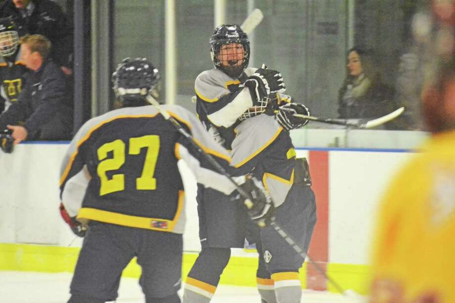Housatonic-Northwestern-Wamogo's Andy Shepard celebrates with Jason Diamond and James Heuschkel (27) after scoring the game tying goal with 28 seconds left. The Mountaineers tied Sheehan 2-2. Photo: Pete Paguaga — Register Citizen