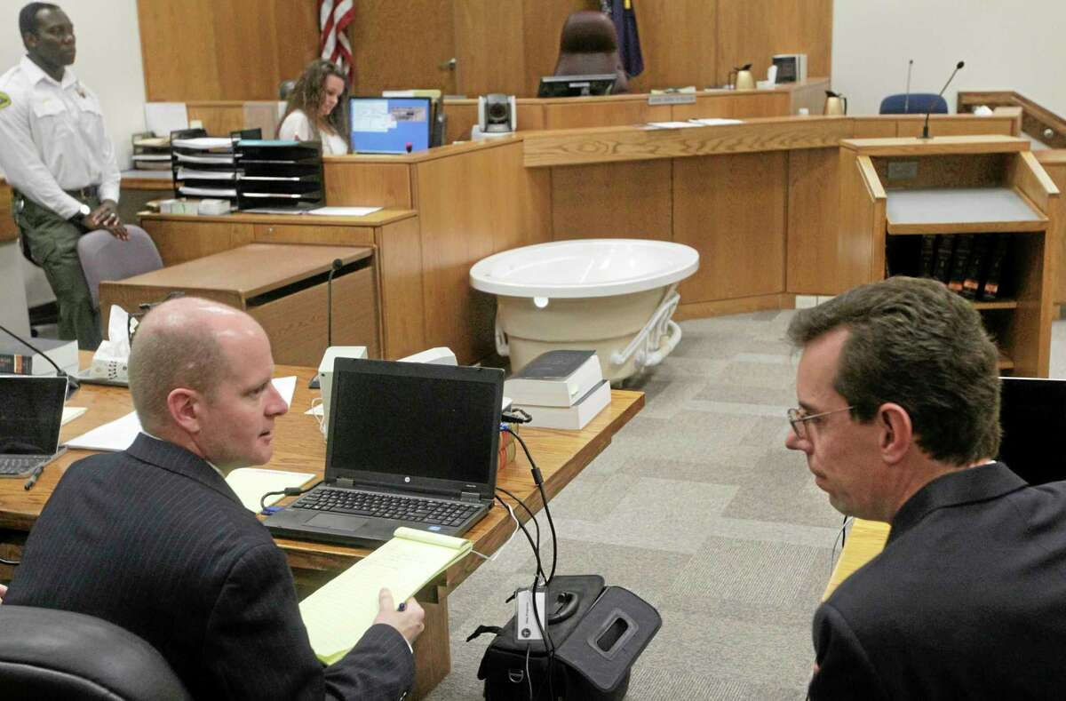 Prosecuter Chad Grunander, left, and Defense attorney Randy Spencer talk during a recess during Martin MacNeill's trial in Judge Derek Pullan's 4th District Court in Provo, Utah, Friday, Oct. 18, 2013. MacNeill, a former Utah doctor, is accused of killing his wife, Michele, after convincing her to get a face-lift, giving her a lethal combination of prescription drugs for recovery and then helping her into the bathtub. The trial is resuming for a second day, with testimony from a dispatcher, police, paramedics and neighbors, and prosecutors said they're showing the same model of bathtub the couple used at their home in 2007. Defense lawyers say they aren't objecting to the demonstration. (AP Photo/The Salt Lake Tribune, Al Hartmann, Pool)